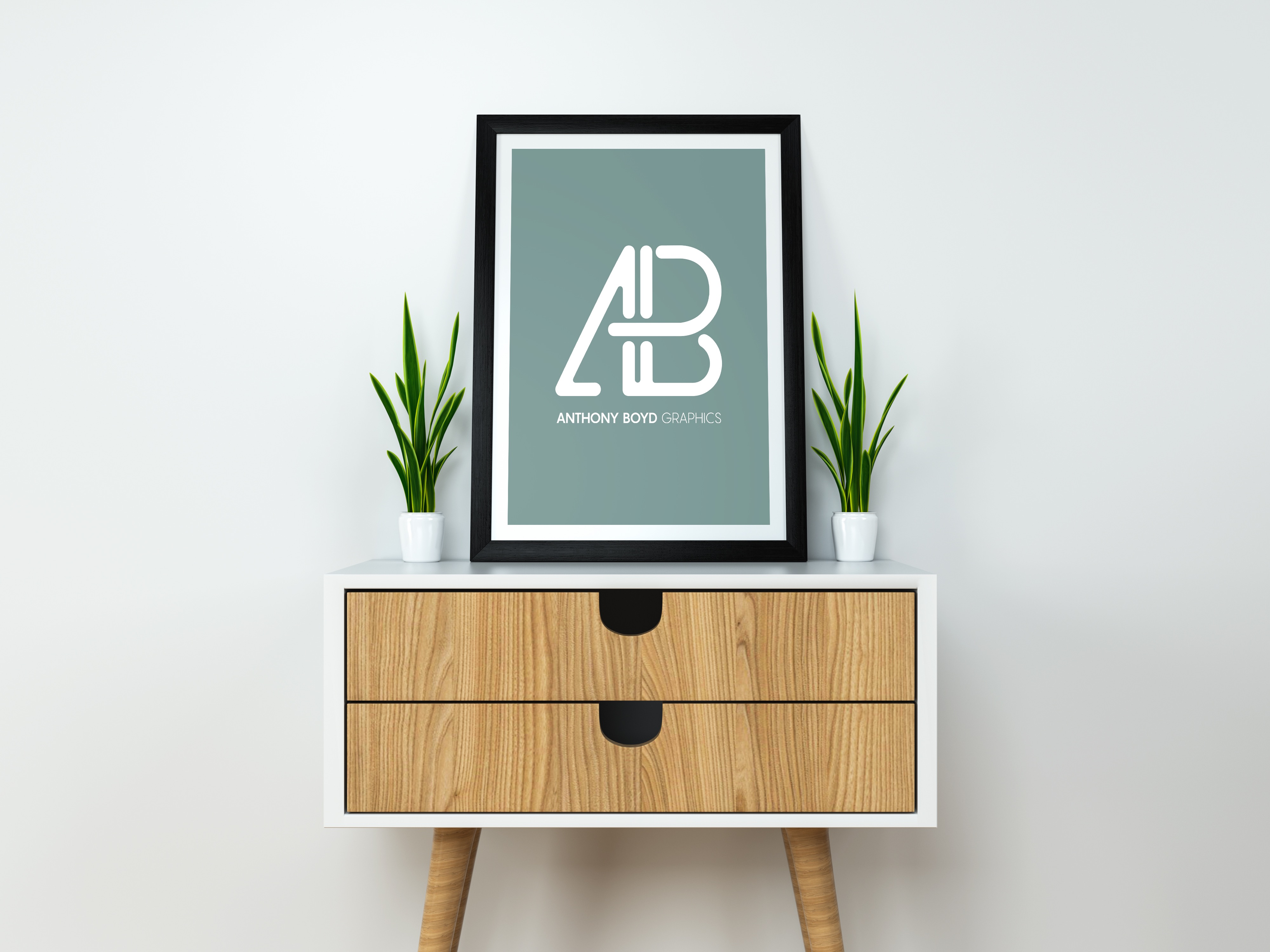 Picture of framed poster standing on a desk