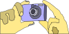 free vector Holding Digital Camera clip art